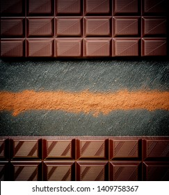 Black chocolate bar, cocoa powder, top view