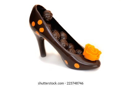 black chocolate shoe with candy and orange rose