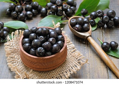 Black chokeberry (Aronia melanocarpa) in wooden bowl, close up view