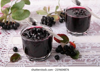 Black chokeberry jam in two small glasses