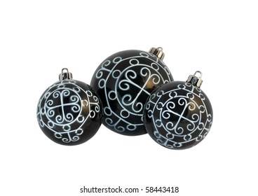 Black Christmas ornaments with white pattern, isolated over white