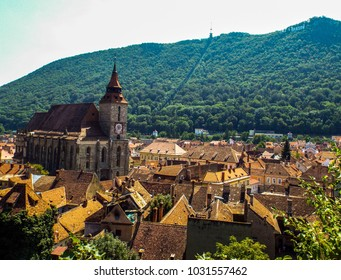 The Black Church (Biserica Neagra) Brasov - Romania. The letters of the name Brasov on the mountain in holywood style