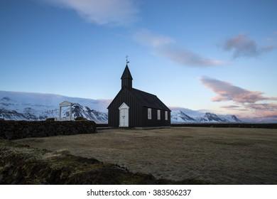 Black church of Budir in Iceland, springtime