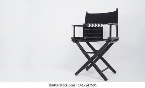 Black Clapper board or movie slate with director chair use in video production or movie and cinema industry. It's put on white background..