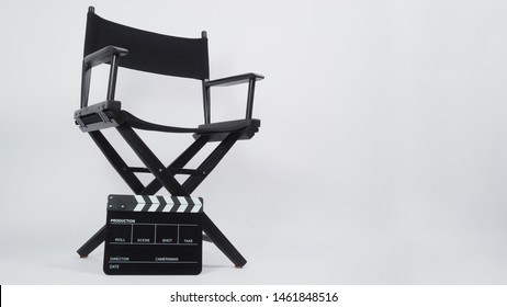 Black Clapper board or movie slate with director chair use in video production or movie and film industry. It's put on white background.