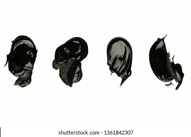 Black clay or charcoal face mask strokes isolated on white