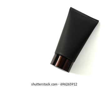 Black cleanser tube isolated on white background. Top view. Copy space.
