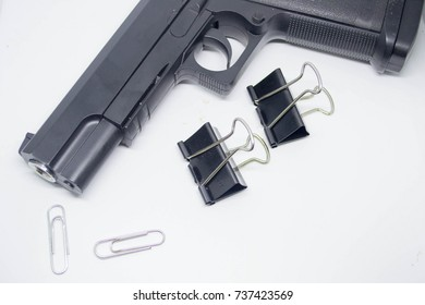 black clip,gun,The paper clip, isolated on white background