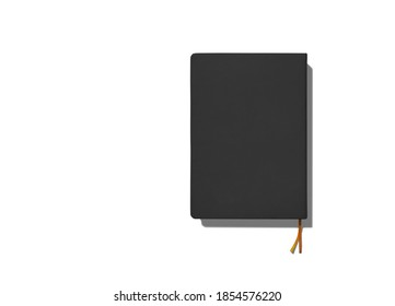 black closed notepad with bookmark on white background, template, place for text