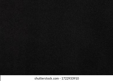 Black cloth texture background. Close-up.