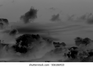 Black clouds on a dark background
