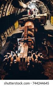 Black coal shearer in underground coal mine