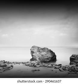 Black coast. Beautiful daytime long exposure photo of beach taken in black and white. Black sea, Odessa, Ukraine