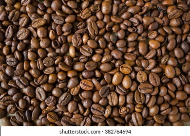 Lot of black coffee beans background