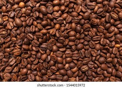Black coffee beans closeup as a background.