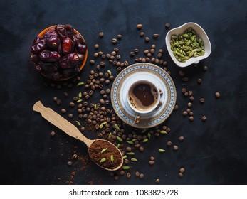 Black coffee with cardamom and dates. Traditional Arabic coffee.