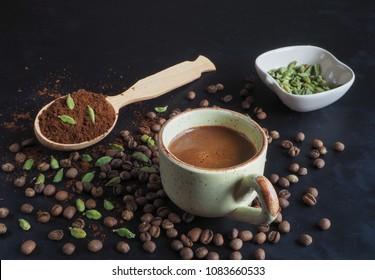 Black coffee with cardamom. Traditional Arabic coffee.