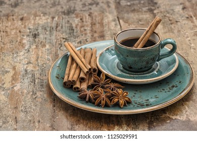 Black coffee with cinnamon and star anise spices. Vintage still life