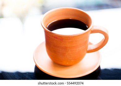 Black coffee in cray cup close up.