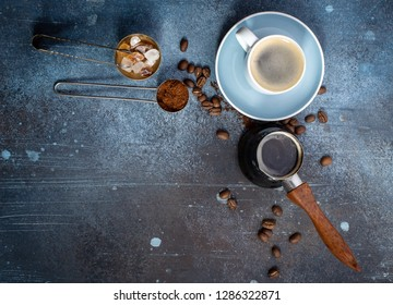 Black coffee cup above. Grunge background with copy space, top view