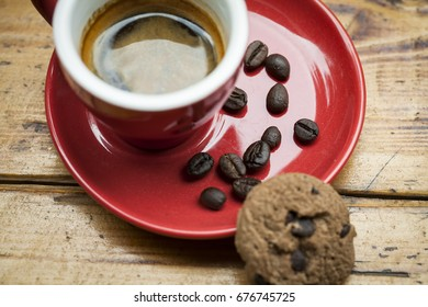 Black coffee cup with a cookie