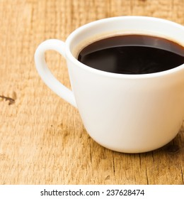 Black coffee cup on wooden table - studio shoot