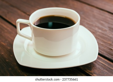 Black coffee cup on wooden background - Vintage effect style pictures