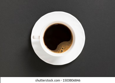 black coffee in a coffee cup top view isolated on black background.