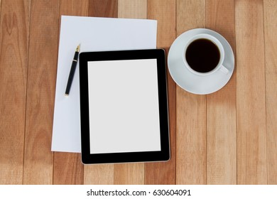 Black coffee with digital tablet and paper on wooden background