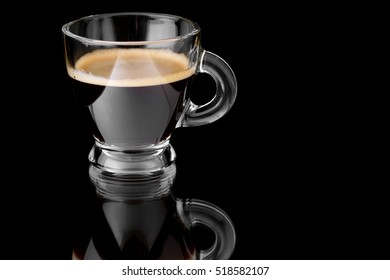 Black coffee espresso on a glossy black surface