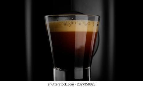 Black coffee with froth. Making black coffee espresso or ristretto in coffee machine