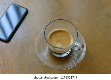 Black coffee in glass on wooden table for refreshment on the morning