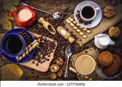 black coffee grains. biscuit. on a dark wooden background.