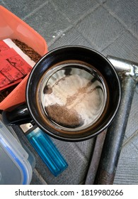 black coffee with match and hammer, view from above