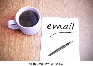 Black coffee on the table with note writing email