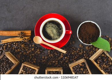 Black coffee  in a red cup with coffee bean decoration on stone table , flat lay image with copy space for your text