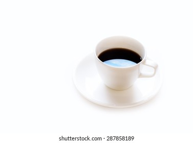 Black Coffee with Sky Reflection