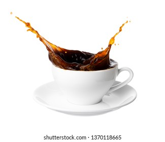 Black coffee splash out of a cup isolated on white background.
