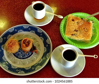 Black coffee and a sweet dish of Arabic cuisine - Kanafeh naamai and Kanafeh bil shaarie. It is a confectionery product. Made from kadaif vermicelli and goat cheese.