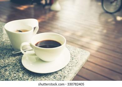 Black coffee and tea outdoor on wood terrace