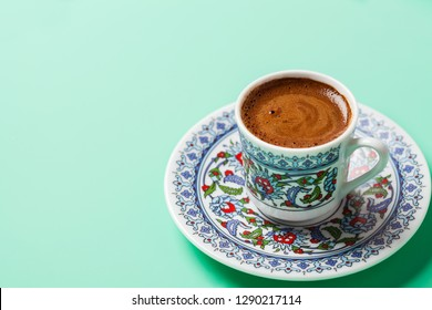 Black coffee in traditional Turkish cup with copy space