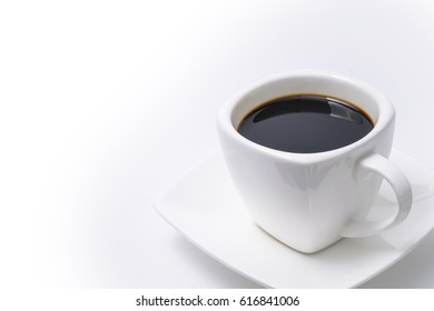Black coffee in white cup with white background