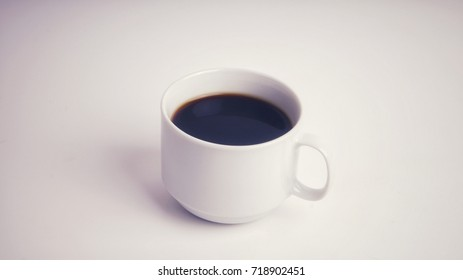Black coffee in white cup isolated on white background