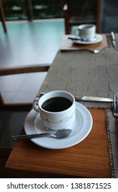 black coffee in white mug on the table