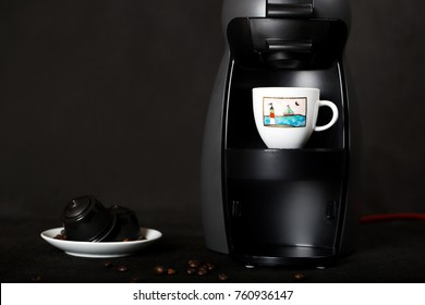 Black coffeemaker and coffee capsules n a black background. Closeup