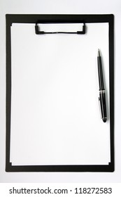 Black color clip board with blank paper and ball pen