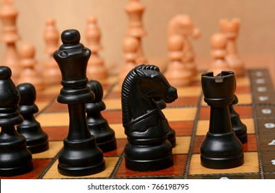 Black Color Knight and King on chess board background