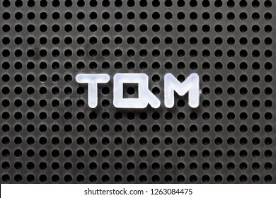 Black color pegboard with white letter in word TQM (Abbreviation of total quality management)