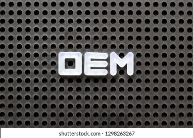 Black color pegboard with white letter in word OEM (Abbbreviation of Original Equipment Manufacturer)