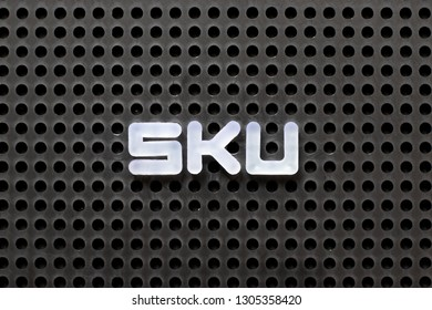 Black color pegboard with white letter in word SKU (abbreviation of stock keeping unit)